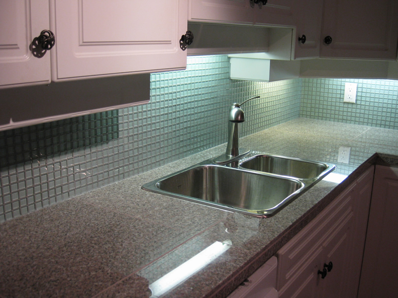 after picture of new granite tile countertop and glass mosaic backsplash