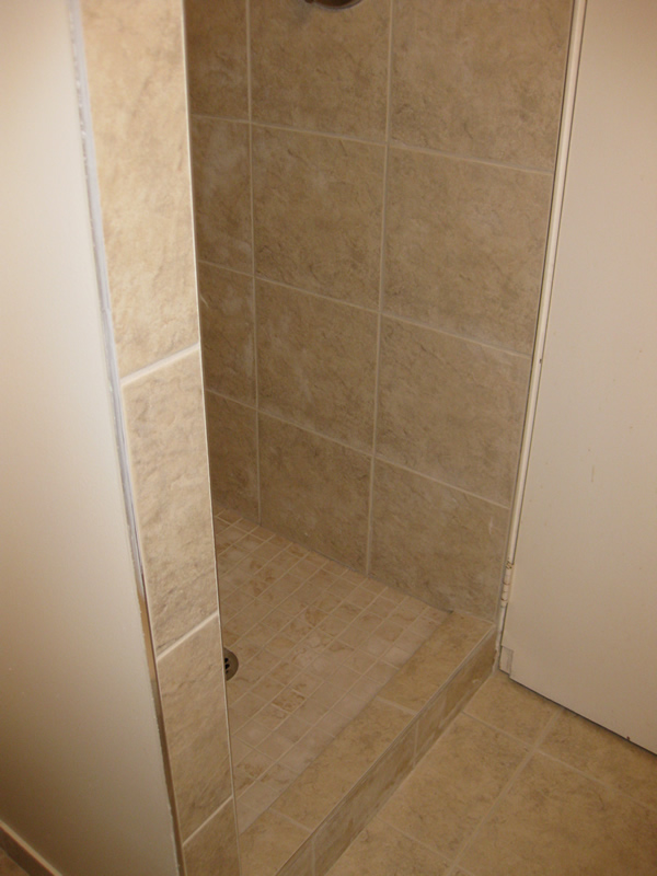 small tiled walk-in shower