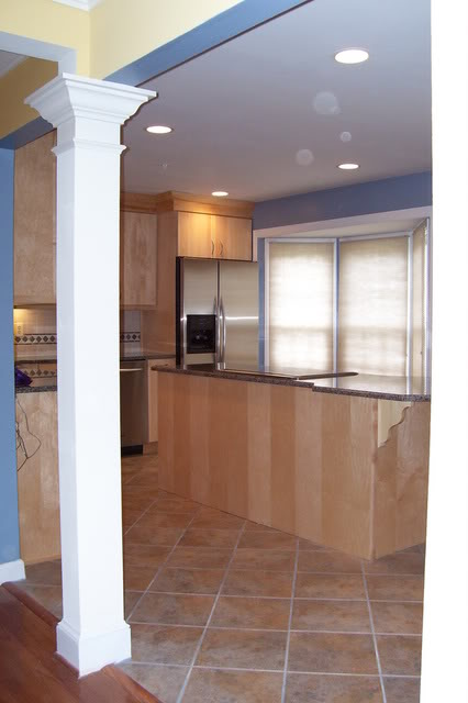 large kitchen island with diagonal porcelain tile floor