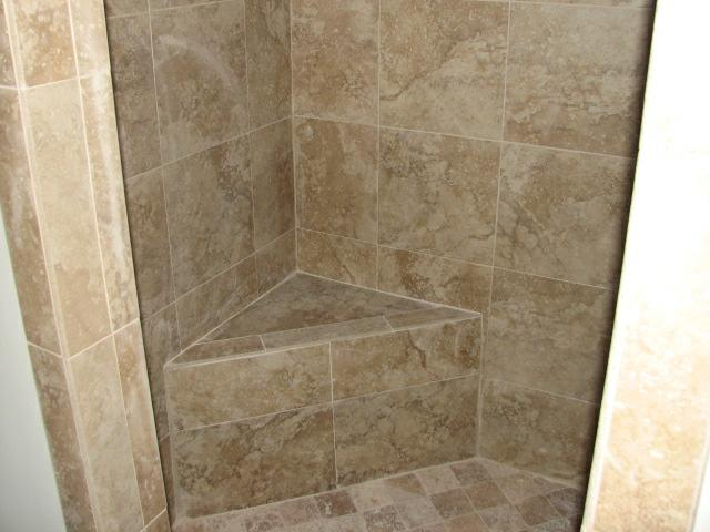 tiled walk-in shower with corner seat